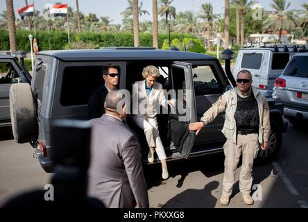 Bagdad, Iraq. 16th Sep, 2018. Ursula von der Leyen (CDU), Federal Minister of Defence, arrives at the Iraqi Ministry of Defence in an armoured off-road vehicle accompanied by security forces. The minister is in Baghdad for political talks. Credit: Kay Nietfeld/dpa/Alamy Live News - Stock Photo