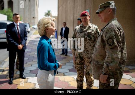 Bagdad, Iraq. 16th Sep, 2018. Ursula von der Leyen (CDU), Federal Minister of Defence, will be received by Paul LaCamera (r), US Lieutenant General, and Christian von Blumröder (M), leader of the German contingent, at the headquarters of the Anti-IS mission in Iraq. The minister is in Baghdad for political talks. Credit: Kay Nietfeld/dpa/Alamy Live News - Stock Photo