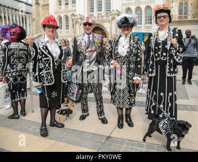 London UK  16 September 2018 Pearly Kings and Queens Harvest Festival at Guildhall Yard,Dressed in their best dark suits covered in hundreds of bright pearl buttons, the Pearly Kings and Queens of London got  together for the biggest event in the Pearly calendar, .@Paul Quezada-Neiman/Alamy Live Credit: Paul Quezada-Neiman/Alamy Live News Credit: Paul Quezada-Neiman/Alamy Live News - Stock Photo