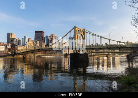 Urban waterfront and bridges crossing the Allegheny River in downtown Pittsburgh, Pennsylvania. - Stock Photo