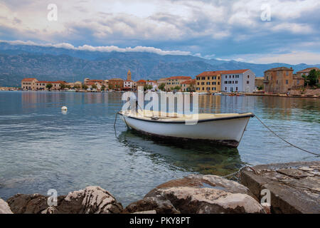 Traditional old village Vinjerac, Croatia, Velebit mountains and Paklenica national park in background - Stock Photo