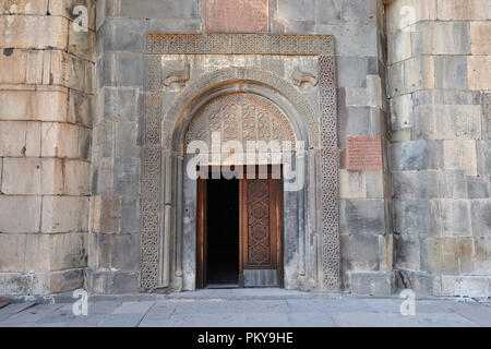 Geghard monastery near Yerevan  is a medieval monastery in the Kotayk province of Armenia, being partially carved - Stock Photo