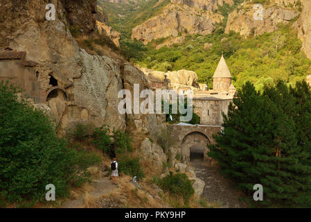 Geghard monastery near Yerevan  is a medieval monastery in the Kotayk province of Armenia, being partially carved out - Stock Photo