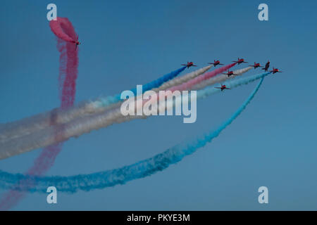 The Red Arrows perform the Tornado formation on Armed Forces Day at Llandudno - Stock Photo