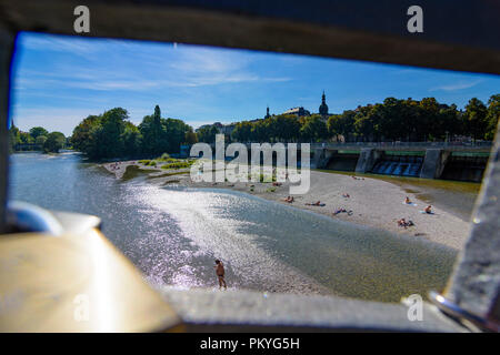 München, Munich: river Kleine Isar, view through bridge Kabelsteg with love padlock, sunbather, Wehrsteg, Oberbayern, Upper Bavaria, Bayern, Bavaria,  - Stock Photo