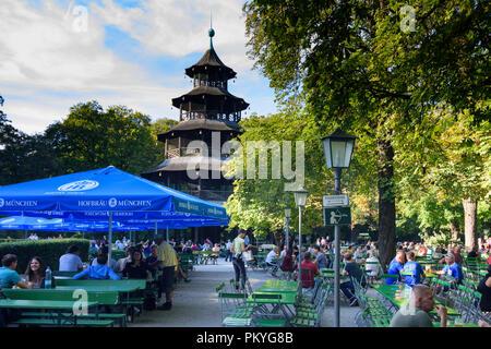 München, Munich: Biergarten am Chinesischen Turm (Beer garden at the Chinese tower) in Englischer Garten (English Garden), Oberbayern, Upper Bavaria,  - Stock Photo