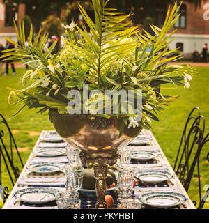 Rustic green garden party centerpiece. - Stock Photo