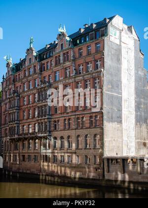 View at historic building from 1907 named Globushof at Nikolaifleet in Hamburg, Germany. - Stock Photo