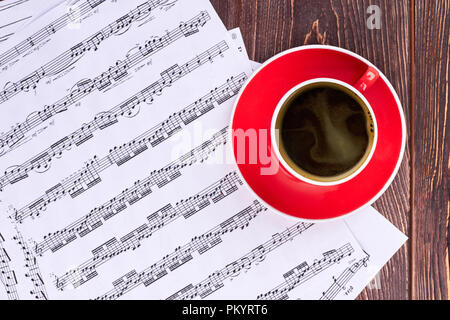 Blank cup and musical notes. - Stock Photo