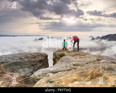 Travel photographer man taking nature video of mountain lookout. Hiker tourist professional photographer and videographer on adventure vacation shooti - Stock Photo