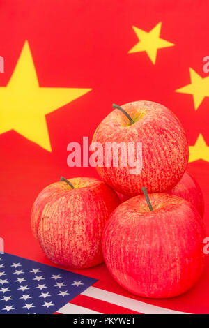 American flag + U.S. red apple exports with Chinese flag - metaphor US apple industry, Chinese trade tariffs on US apple imports, US-China trade war - Stock Photo