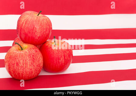 Red apples with U.S. American flag / Stars and Stripes - metaphor US apple industry, Apple Day,  and Chinese trade tariffs on imports of U.S. apples. - Stock Photo