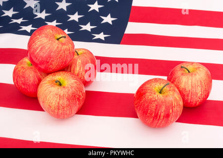 Red apples with US American flag / Stars and Stripes - metaphor US apple industry, Apple Day, and Chinese trade tariffs on imports of US apples. - Stock Photo