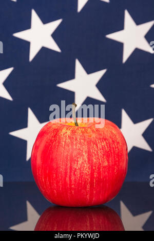 Red apples with U..S American flag / Stars and Stripes - metaphor US apple industry, Apple Day, and Chinese trade tariffs on imports of U.S. apples. - Stock Photo
