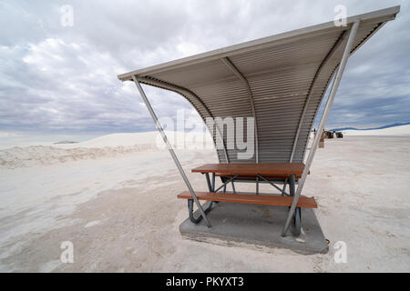 Retro style picnic tables and rest areas inside of White Sands National Monument in New Mexico - Stock Photo