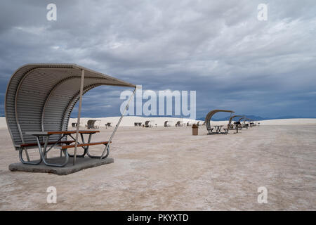 Picnic tables in White Sands National Monument. Rest areas for guests to eat lunch - Stock Photo