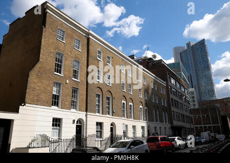 A view of refurbished row terraced housing flats in Christopher Street  near Broadgate Tower & Liverpool Sreet Station in London EC2 UK  KATHY DEWITT - Stock Photo