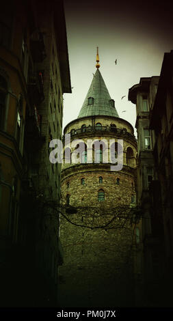 View of old narrow street with the Galata Tower - Stock Photo
