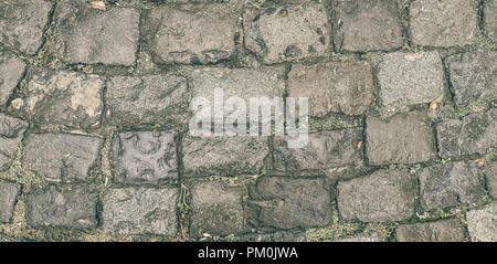 The old road of broken paving stones. It can be used for backgrounds, textures in the graphic editors - Stock Photo
