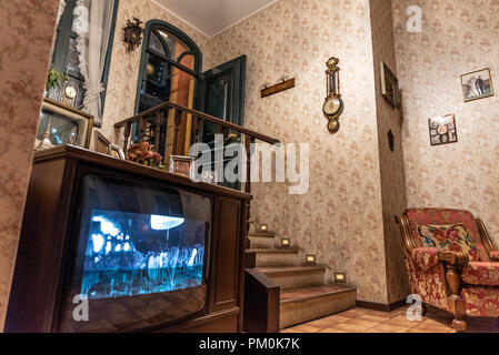 Interior of a fifties house, wooden details and wallpaper on the walls, vertical image - Stock Photo