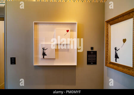 Bansky artwork in Moco Museum in Amsterdam, Netherlands - Stock Photo