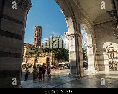 Piazza Antelminelli with the tower of the Church of Saint John & Reparata, as seen from the Cathedral of St Martin, city of Lucca, Tuscany, Italy - Stock Photo