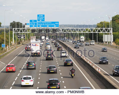View looking down on traffic on the M25 London orbital motorway near junction 21 in Hertfordshire - Stock Photo