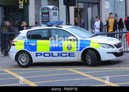 A Police car parked at the end of Briggate in Leeds City Centre - Stock Photo