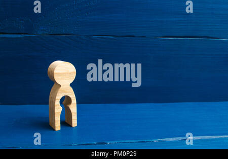 . The concept of the loss of child, abortion of pregnancy, miscarriage. Infertility in women. unhappy mother lost her child. A wooden figure of a woma - Stock Photo