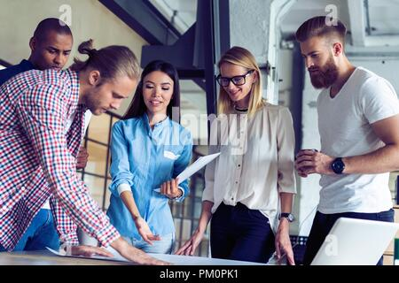 Successful team. Group of young business people working and communicating together in creative office. - Stock Photo