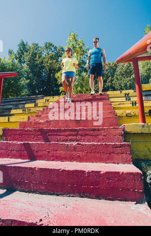 Two runners jogging on downstairs - Stock Photo