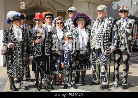 Guildhall Yard, London, UK, 16th Sep 2018. The 20th anniversary of the annual Pearly Kings and Queens Harvest Festival sees the pearlies in their traditional pearl button covered suits and dresses celebrating with Morris dancing, maypole dancing, the Mayors of London and marching bands at Guildhall Yard, before parading through the City of London to St Mary Le Bow Church for a service of thanksgiving. Credit: Imageplotter News and Sports/Alamy Live News - Stock Photo