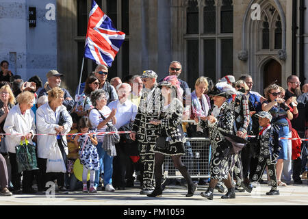 Guildhall Yard, London, UK,16th Sep 2018. The 20th anniversary of the annual Pearly Kings and Queens Harvest Festival sees the pearlies in their traditional pearl button covered suits and dresses celebrating with Morris dancing, maypole dancing, the Mayors of London and marching bands at Guildhall Yard, before parading through the City of London to St Mary Le Bow Church for a service of thanksgiving. Credit: Imageplotter News and Sports/Alamy Live News - Stock Photo