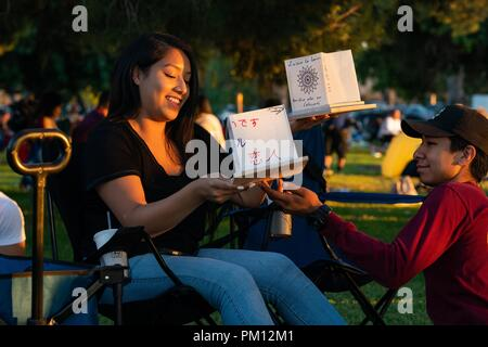 Los Angeles, USA. 15th Sep, 2018. People make water lanterns at the Water Lantern Festival in Los Angeles, the United States, Sept. 15, 2018. Credit: Qian Weizhong/Xinhua/Alamy Live News - Stock Photo