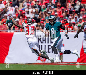 Tampa, Florida, USA. 16th Sep, 2018. Philadelphia Eagles quarterback Nick Foles (9) scrambles and runs in the 1st half during the game between the Philadelphia Eagles and the Tampa Bay Buccaneers at Raymond James Stadium in Tampa, Florida. Del Mecum/CSM/Alamy Live News - Stock Photo