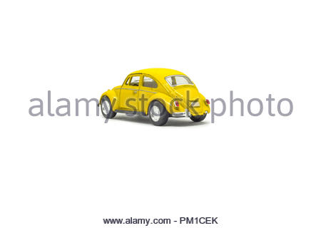 Isolated used yellow toy car, rear view - Stock Photo