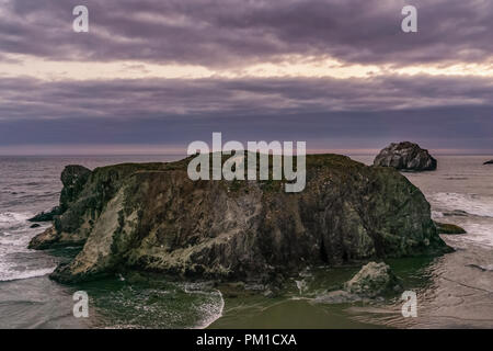 Sea Stack of Bandon Beach at dusk, Face Rock State Scenic Viewpoint, Pacific Coast, Oregon, USA. - Stock Photo