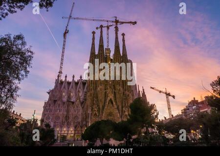 La Sagrada Familia Catholic Church in the Catalan City of Barcelona, Spain.  Designed by Antoni Gaudi the Basilica is still under construction today. - Stock Photo