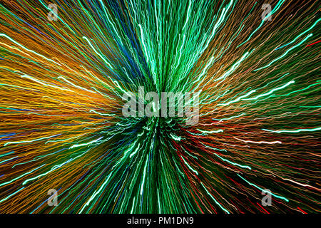 Brightly colored light streaks giving a really strong sense of movement and power, and indicating the fast pace of modern data communication - Stock Photo