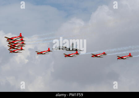 FAIRFORD, UK, JULY 13 2018: A photograph documenting Swiss Air Force Swiss Air Force McDonnell Douglas F/A-18C Hornet, and the PC7 Display Team in for - Stock Photo