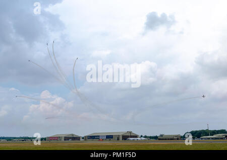 FAIRFORD, UK, JULY 13 2018: A photograph documenting athe Patrulla Aguila from the Spanish Air Force displaying their aerobatic C-101 Aviojet aircraft - Stock Photo