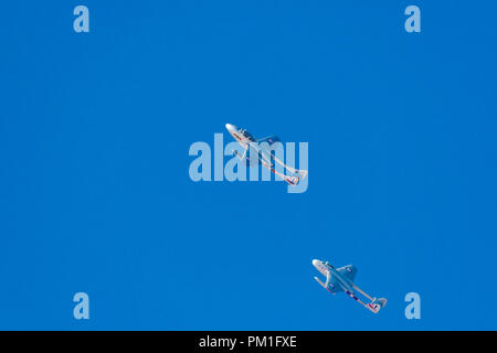 SOUTHPORT, UK JULY 8 2018:  A photograph documenting two De Havilland Vampire aircraft performing a pair display in blue skies at Southport Air show - Stock Photo