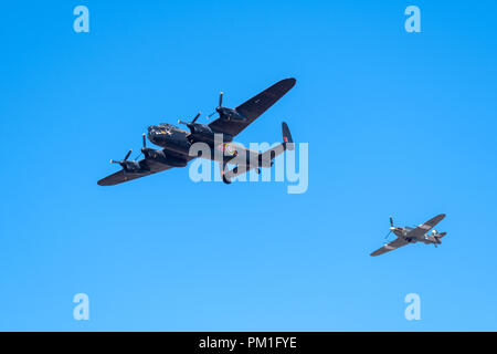 SOUTHPORT, UK JULY 8 2018:  A photograph documenting the Avro Lancaster and Hawker Hurricane from the Battle of Britain Memorial Flight performing at  - Stock Photo