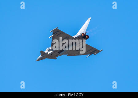 SOUTHPORT, UK JULY 8 2018:  An EU2000 Eurofighter Typhoon performing a flight display in clear blue skies - Stock Photo