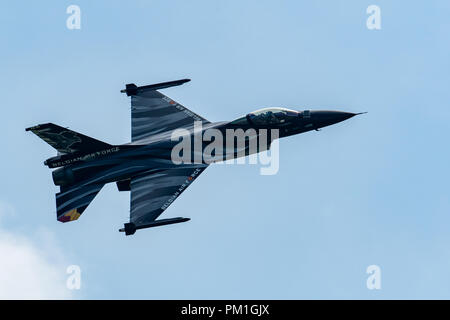 TELFORD, UK, JUNE 10, 2018 - A photograph documenting the Belgian Air Force's F-16 Fighting Falcon display in the skies over the RAF Cosford Air Show  - Stock Photo