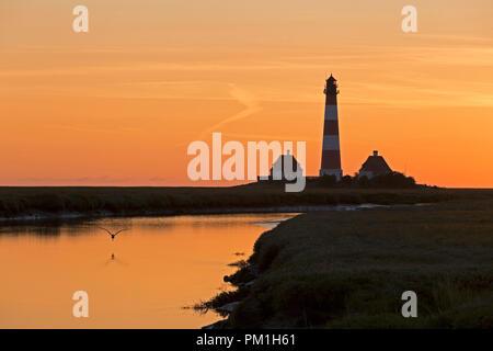 sunset at Lighthouse Westerhever, Schleswig-Holstein, Germany - Stock Photo