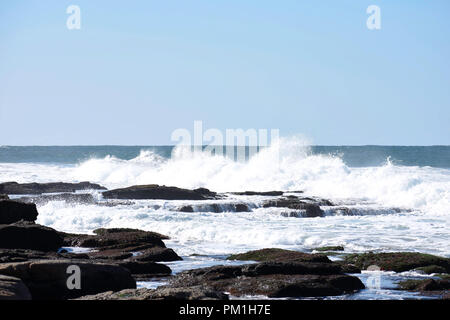 Waves Crashing Into Rock Pools As The Tide Comes In, Uvongo, South Africa - Stock Photo