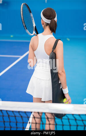 Female Tennis Player Back View - Stock Photo