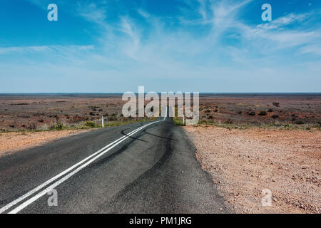 Infinity road with tyre mark in Outback Australia - Stock Photo