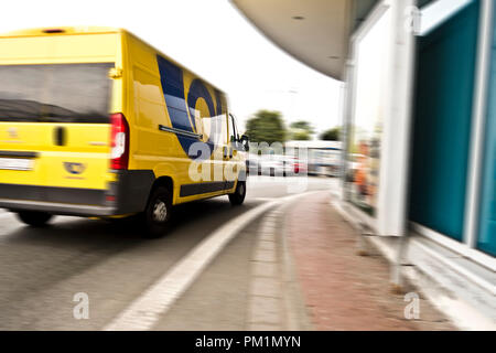 Yellow truck  of Ceska Posta for mail delivery - Stock Photo